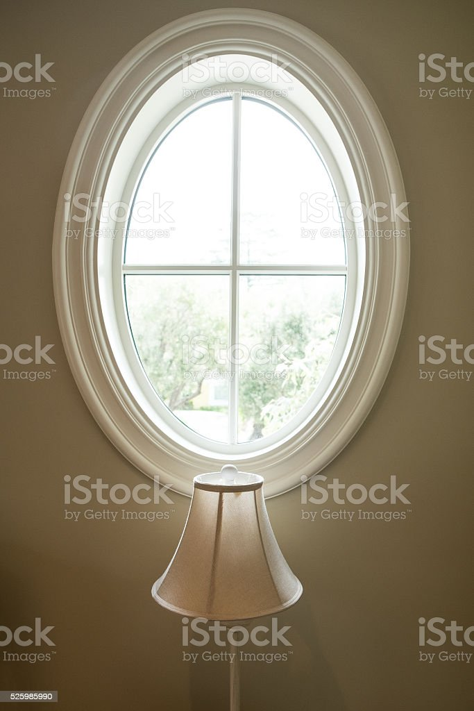 Oval Window with Lamp stock photo