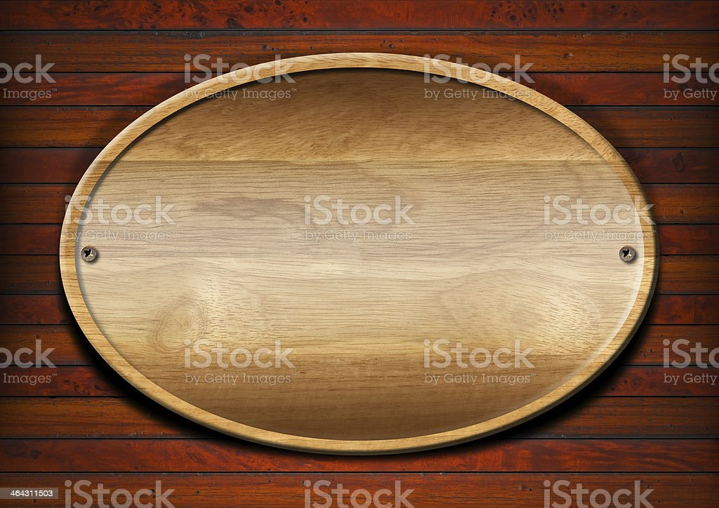 Oval Wood Board on Wall stock photo