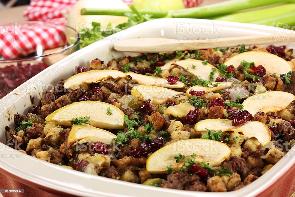Oven dish full with meat stuffing with apple slices stock photo