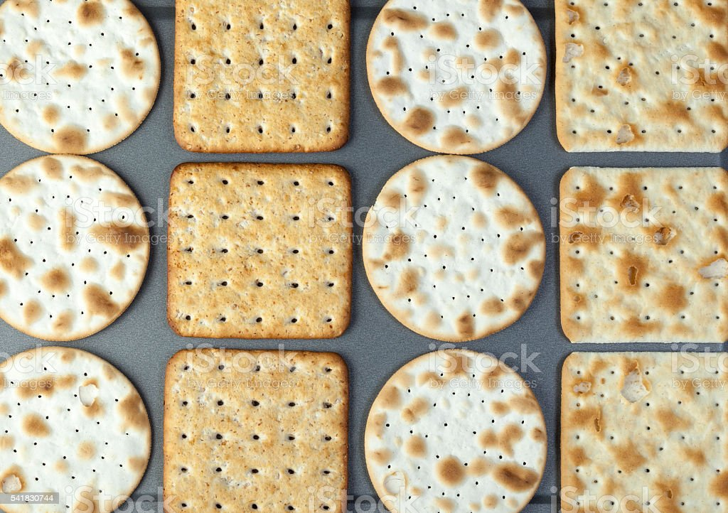 Oven fresh crackers laying on a baking tray stock photo