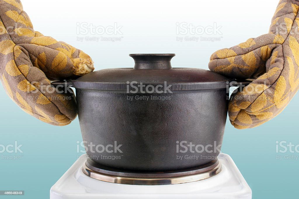 Oven mitts with cauldron royalty-free stock photo