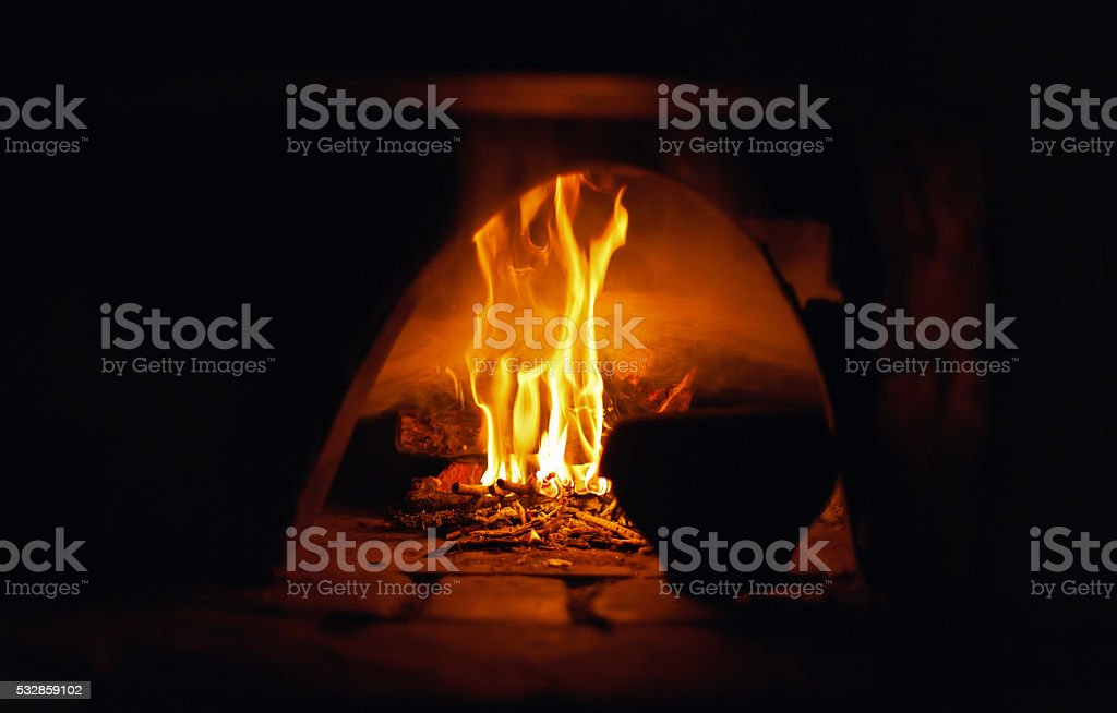 oven open flame burn old pot abstract background natural light stock photo