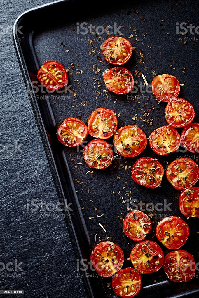 Oven roasted cherry tomatoes stock photo