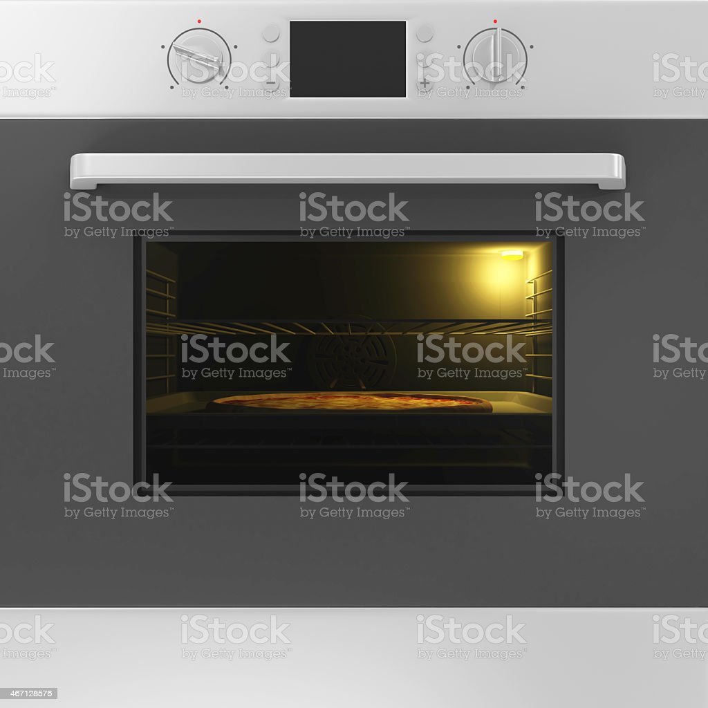 Oven with Closed Door and Pizza on a Tray Inside stock photo