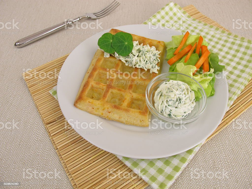 Oven-baked carrot-waffles with cream cheese dip and salad stock photo