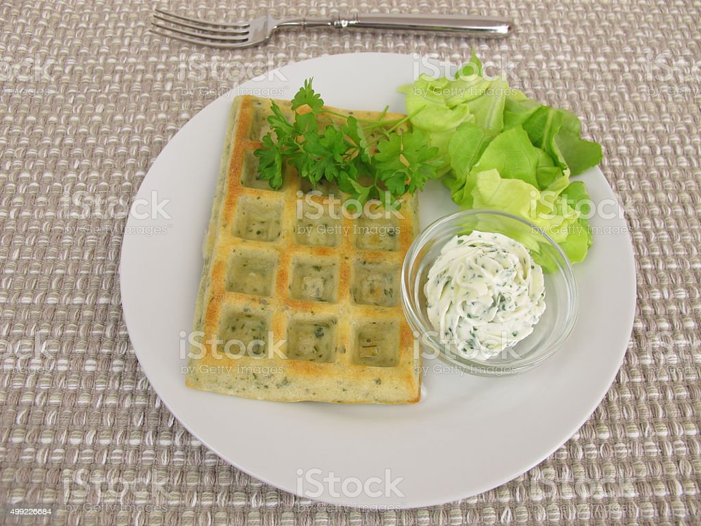 Oven-baked herb-waffles with cream cheese dip and salad stock photo
