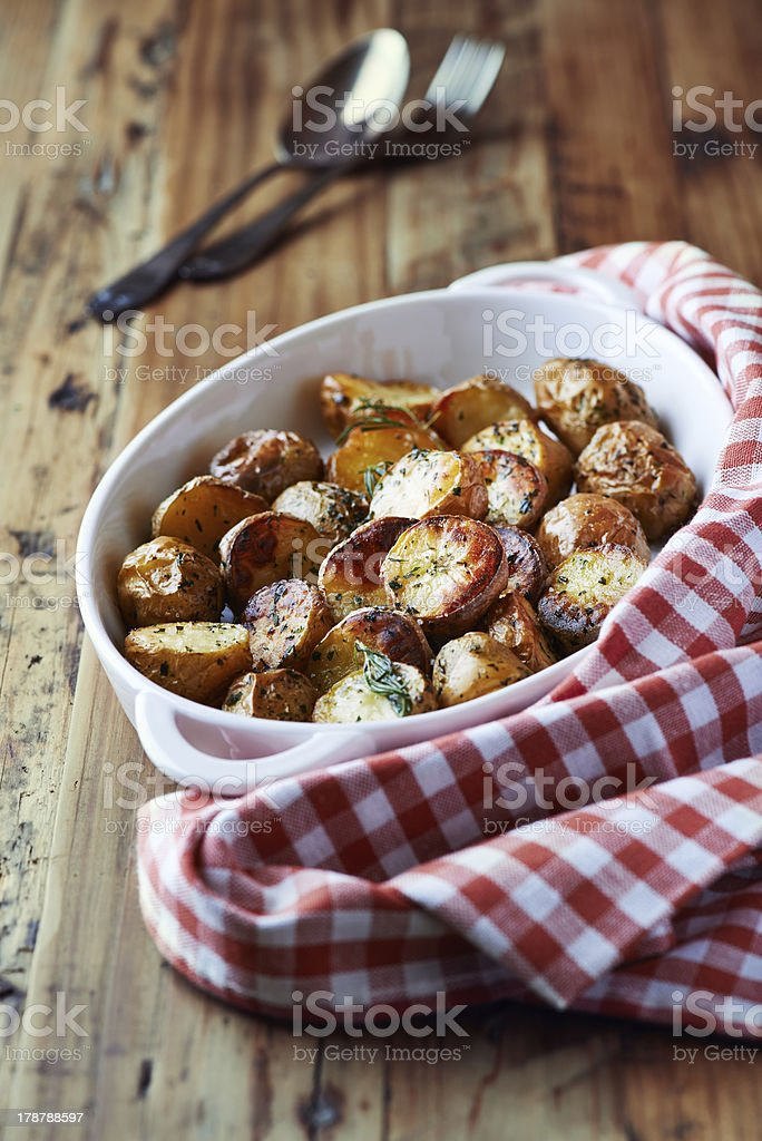 Oven-baked potatoes with sea salt and herbs royalty-free stock photo