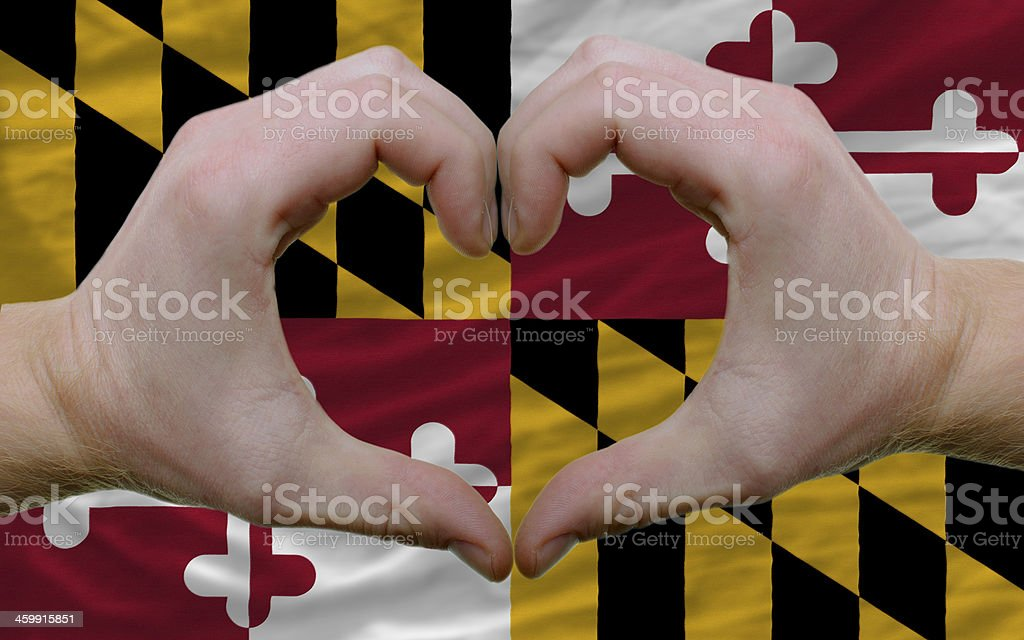 over american state flag maryland showed heart and love gesture stock photo