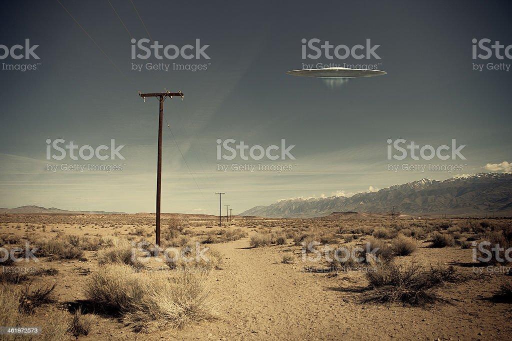 UFO over desert road stock photo