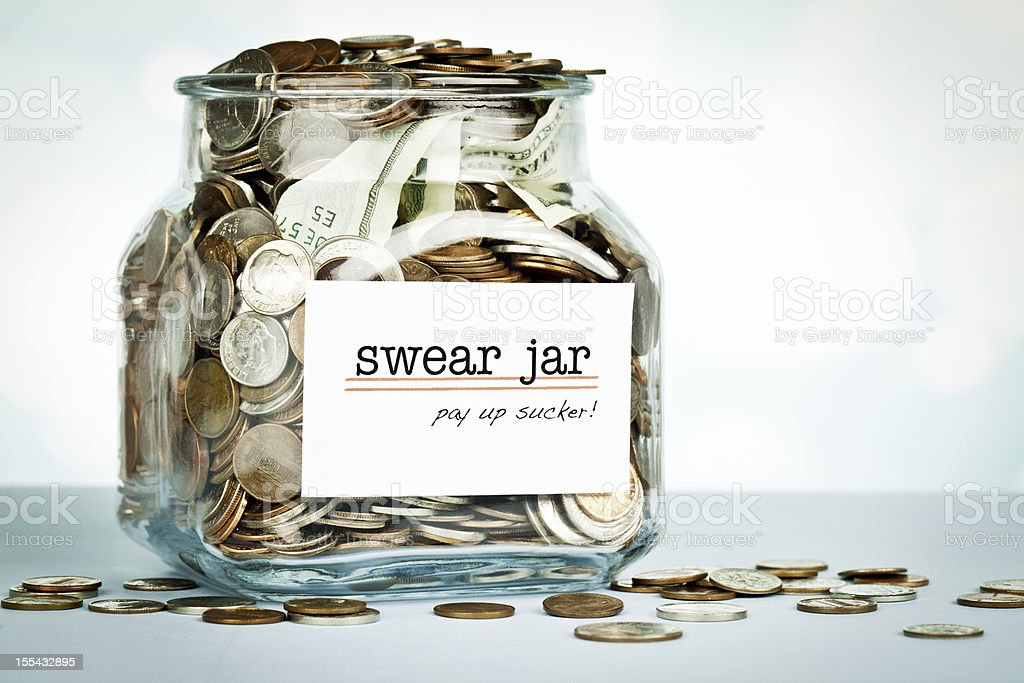 Over Flowing Swear Jar stock photo