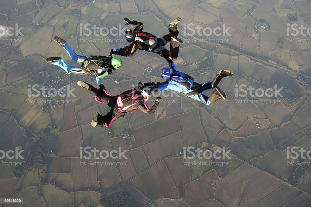 Over head shot of four skydivers in free fall stock photo