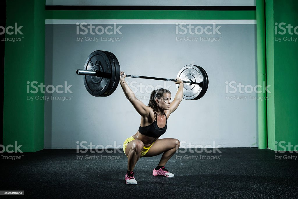 over head squat stock photo