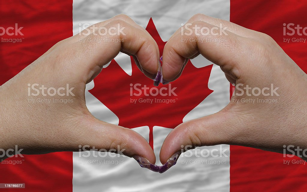 over national flag of canada showed heart and love gesture stock photo