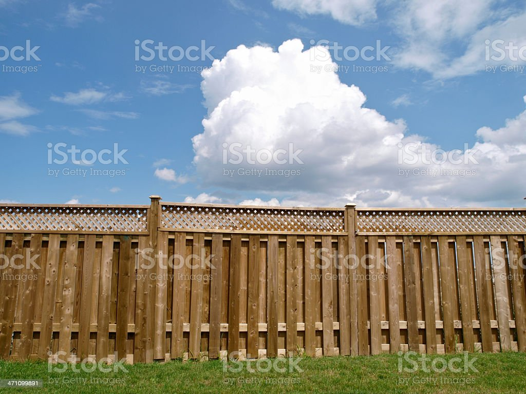 Over the fence in suburbia royalty-free stock photo