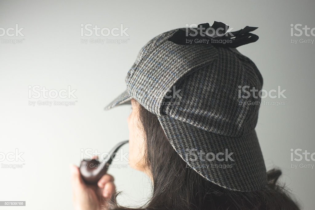 Over the Shoulder Portrait of Woman as Sherlock Holmes stock photo