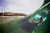 Over under duck dive photo of a surfer girl