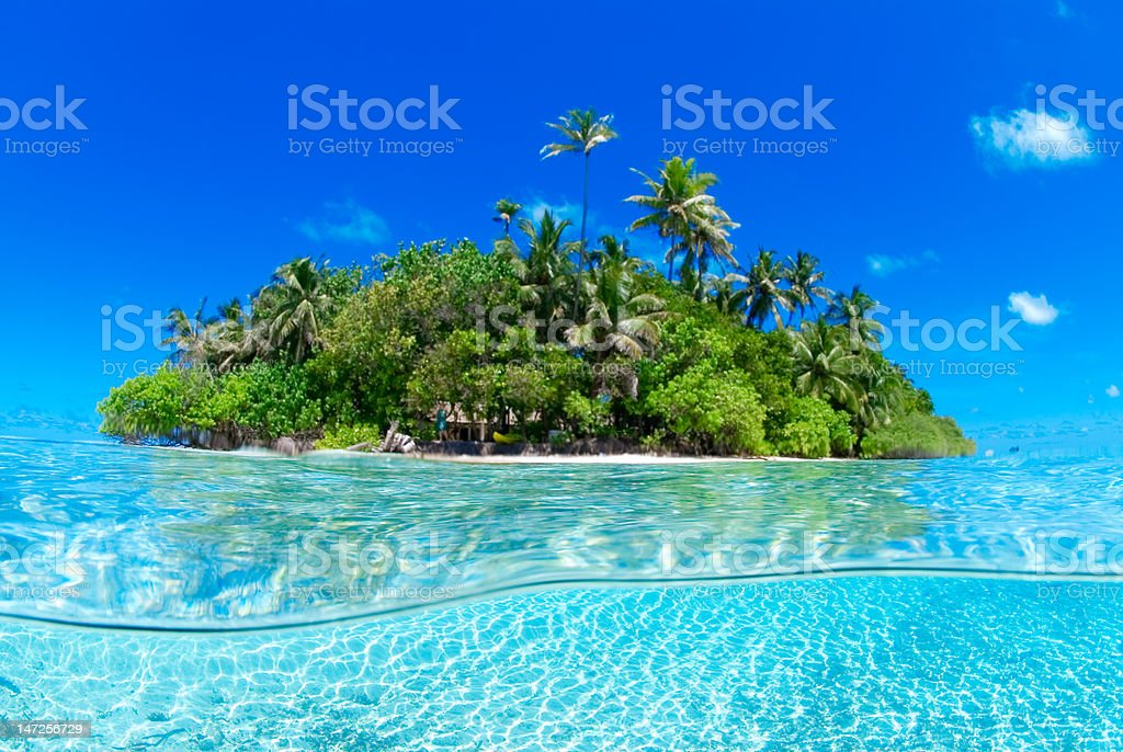 Over under shot of tropical island stock photo