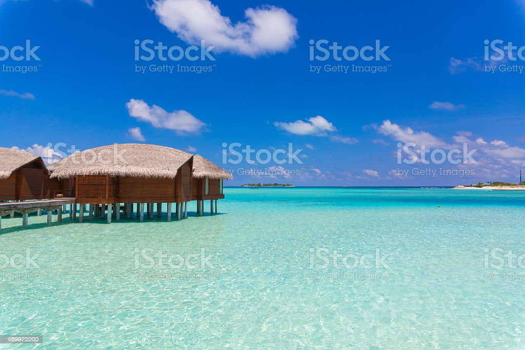 Over Water Bungalow in Maldives in a Sunny Day stock photo