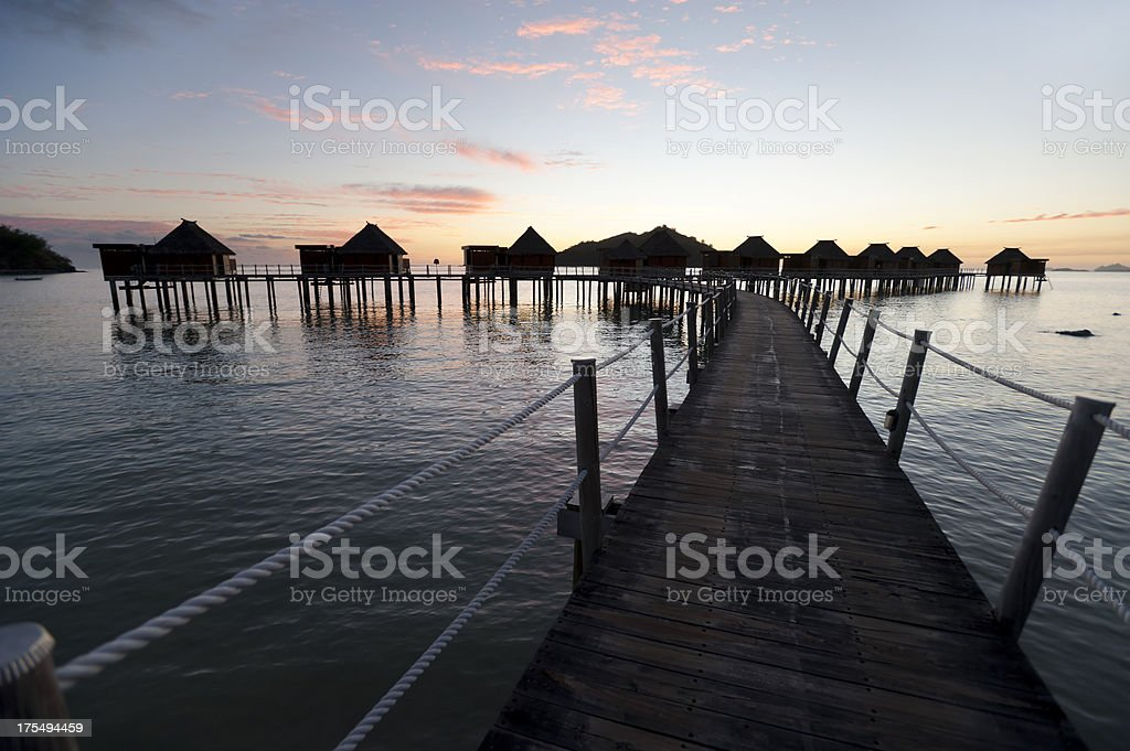 Over water bungalows at sunset stock photo