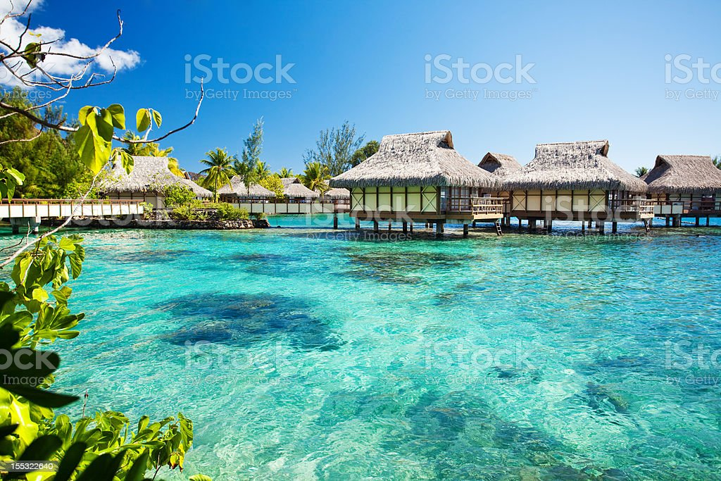 Over water bungalows next to amazing lagoon stock photo