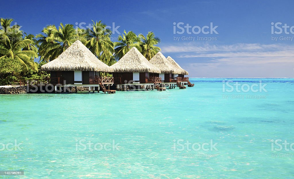 Over water bungalows with steps into amazing lagoon stock photo