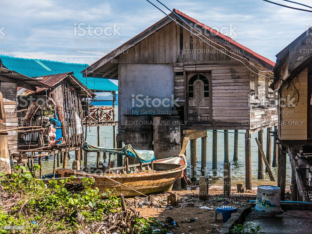 over water traditional sea gypsy fisherman stilt house stock photo