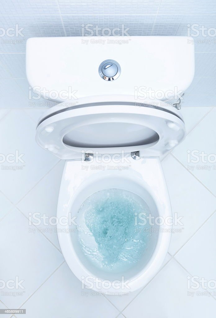 Overboard view of toilet being cleaned stock photo