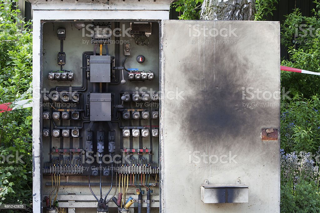 Overburdened circuit board stock photo