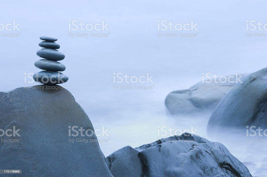 Overcast balanced stones stock photo
