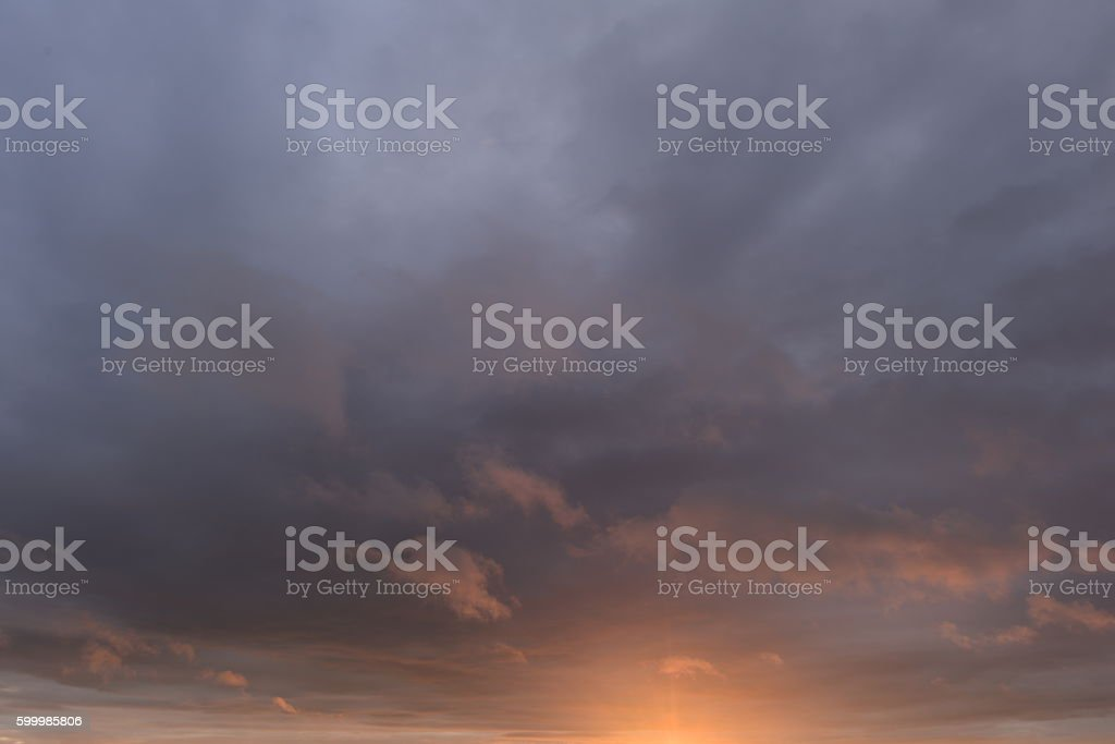overcast cloudy sky at sunset on a summer evening stock photo