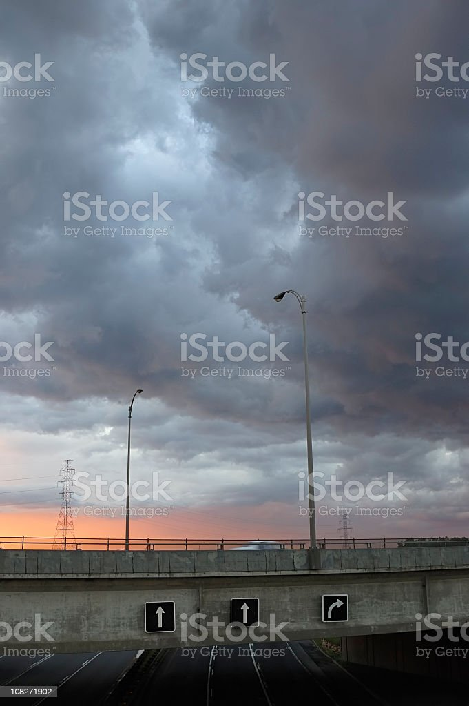 Overcast Dramatic Sky During Sunset Over Highway stock photo