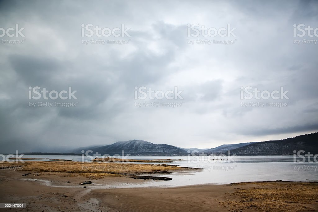 Overcast landscape. River and mountans. stock photo