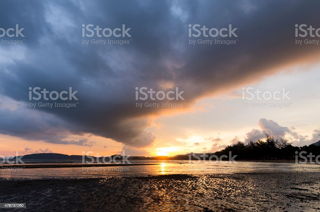 Overcast susnset at beach in Thailand stock photo