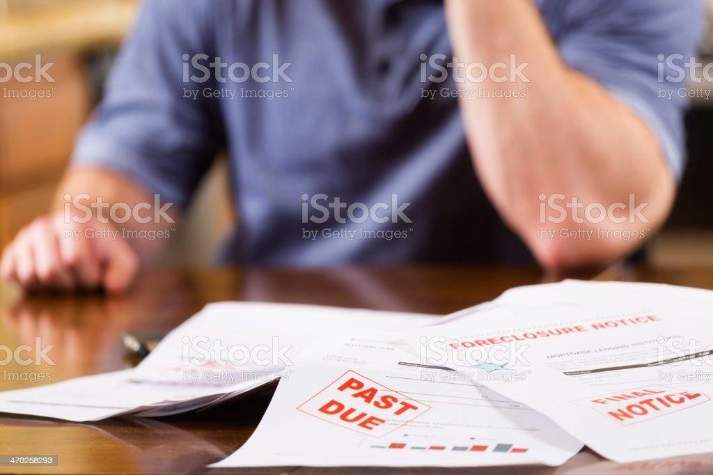 Overcome with Debt stock photo