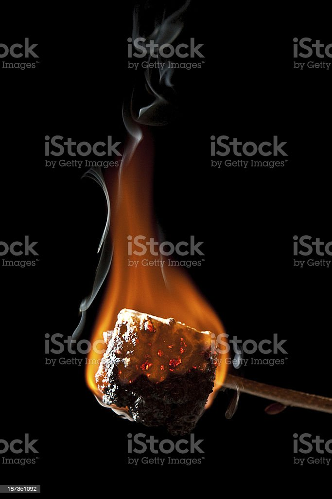 Overcooked Marshmallow Burning and getting all Black stock photo