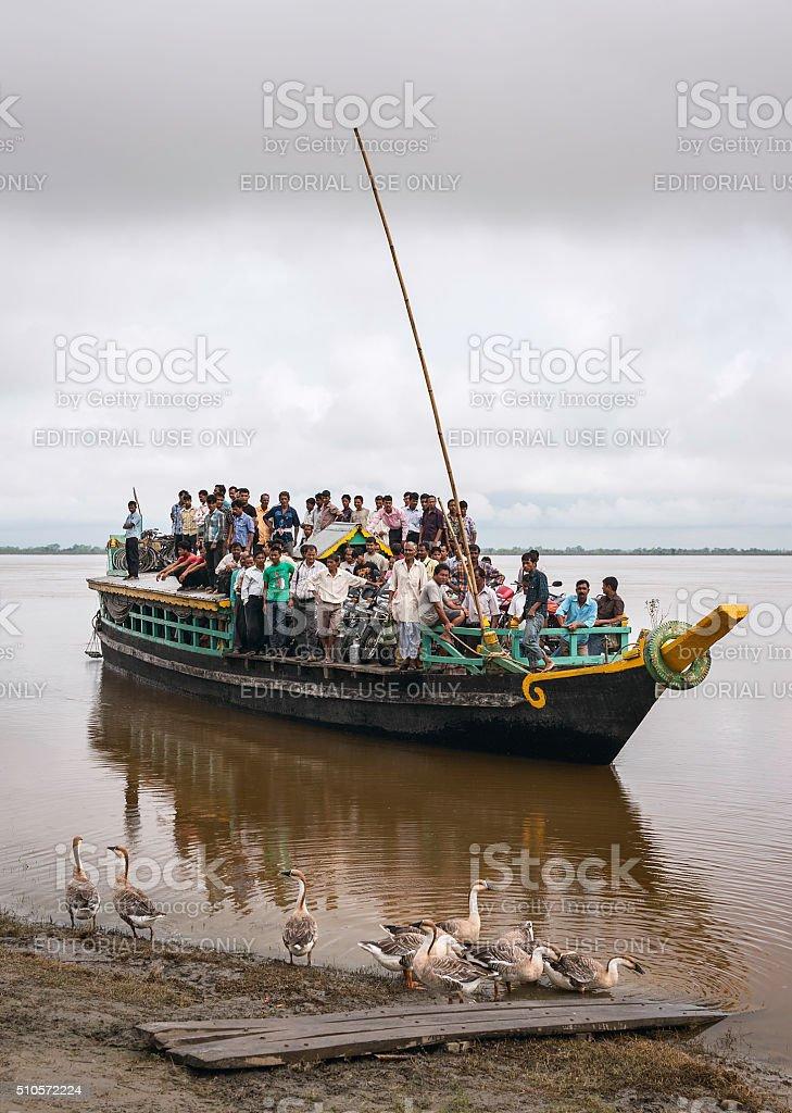 Overcrowded ferry crosses Brahmaputra, Jorhat, Assam, India. stock photo