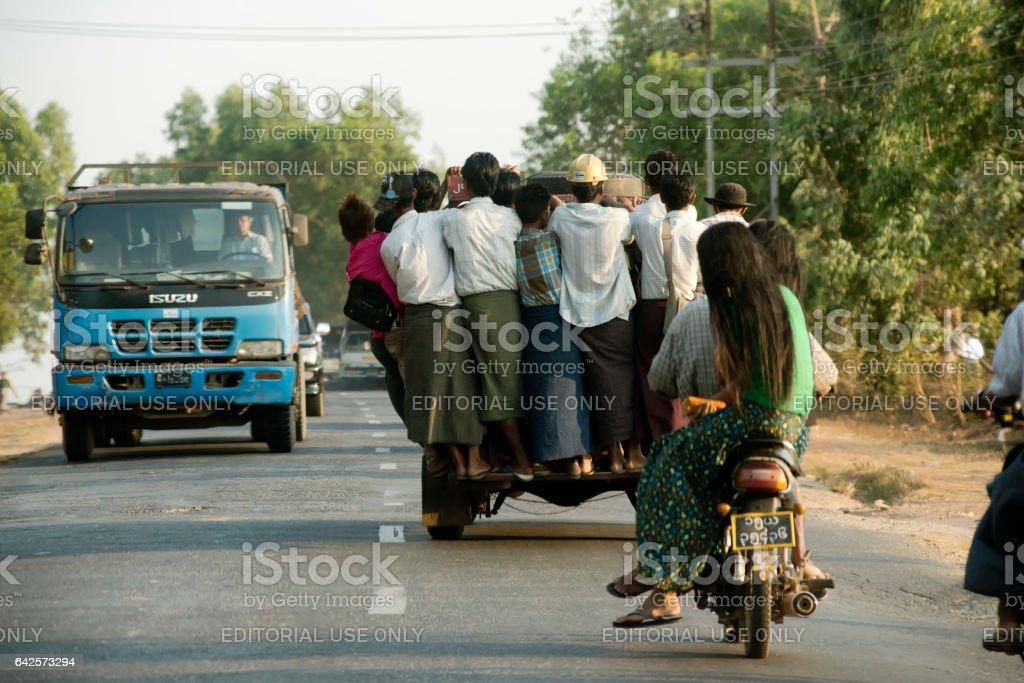 Overcrowded pickup truck on a highway in Yangon.  February 23, 2014 - Rangoon, Myanmar stock photo