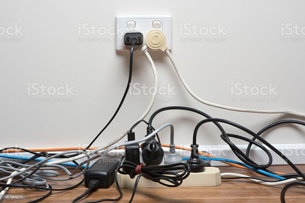 Overcrowded power board stock photo