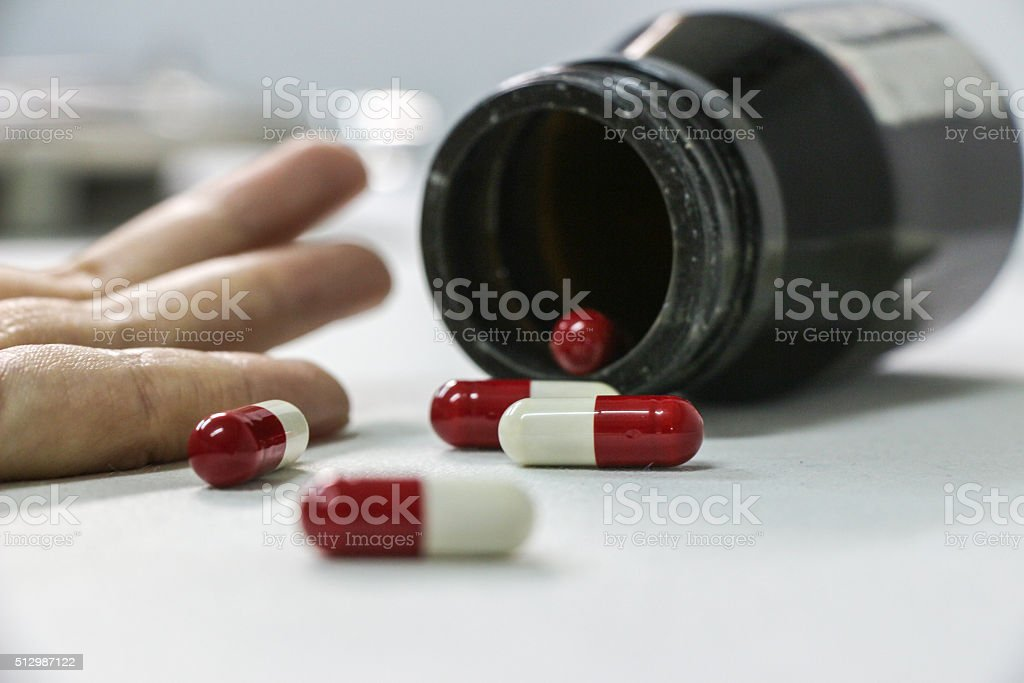 Overdose drug addict hand, drugs narcotic syringe on floor stock photo