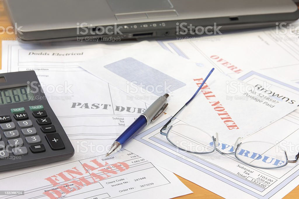 Overdue Bills with Calculator and Laptop royalty-free stock photo