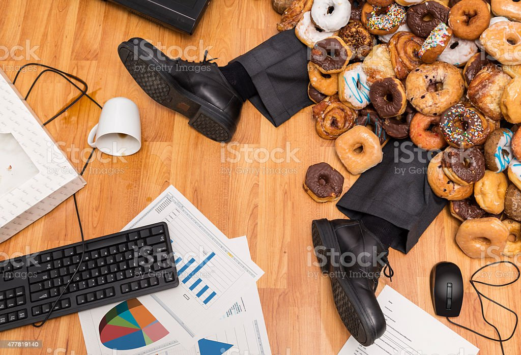 Overeating at work stock photo