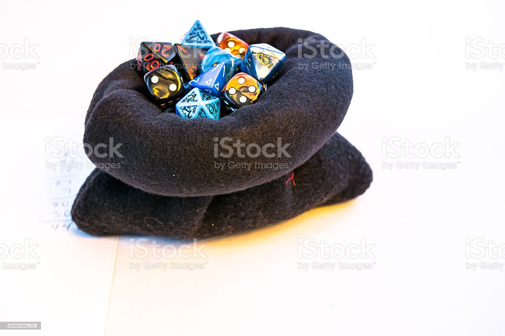 Overflowing bag of dice stock photo