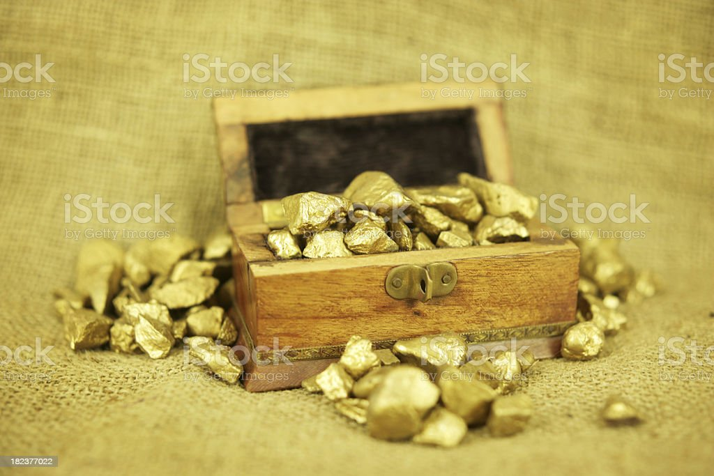 Overflowing chest of gold stock photo
