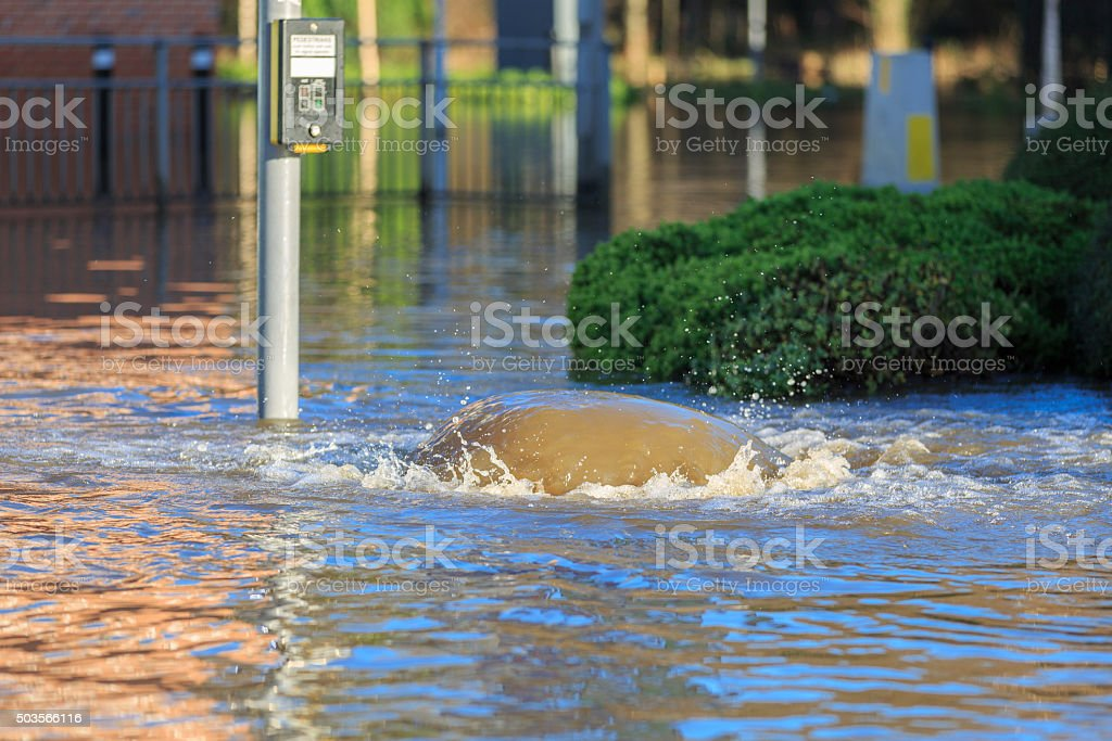Overflowing drain during a flood in Leeds stock photo