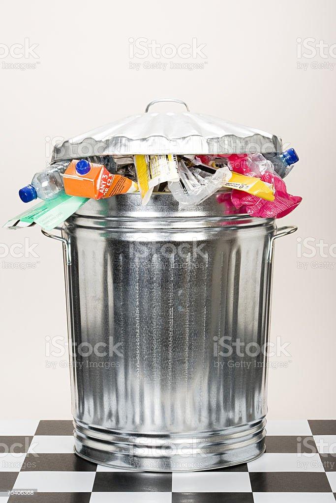 Overflowing dustbin stock photo