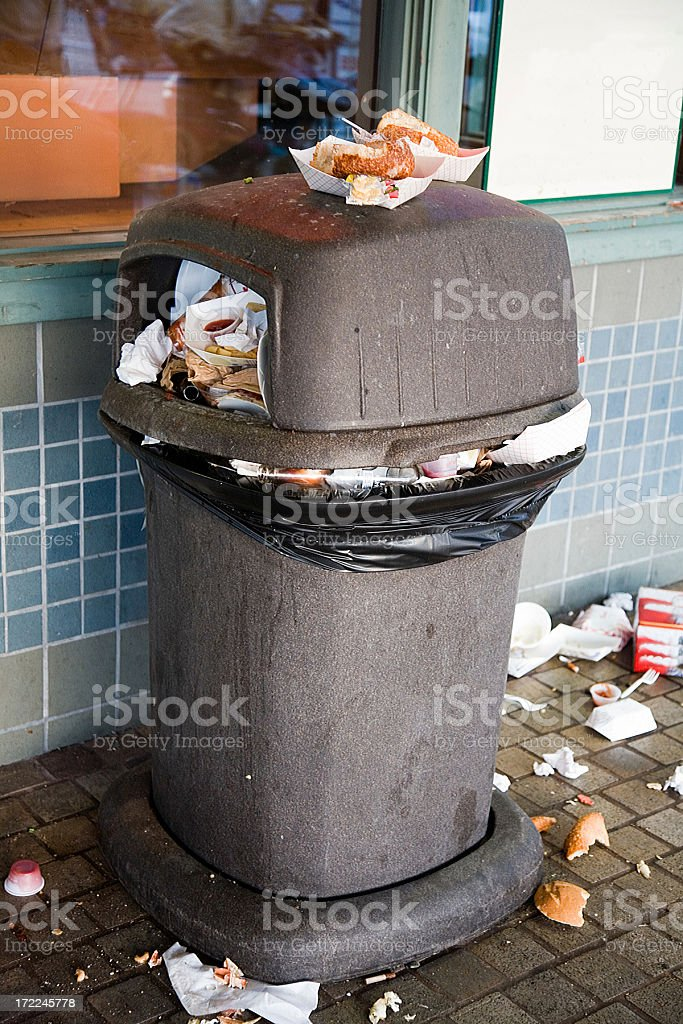 Overflowing Garbage Can royalty-free stock photo