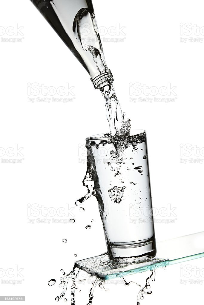 Overflowing glass of water stock photo
