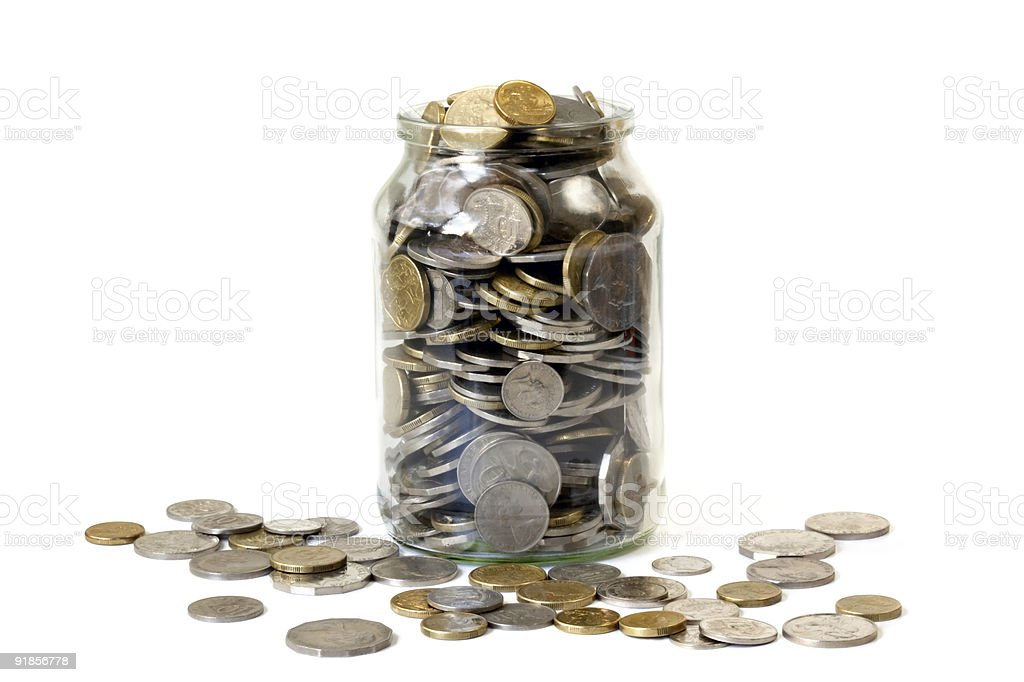 Overflowing Jar of Coins stock photo