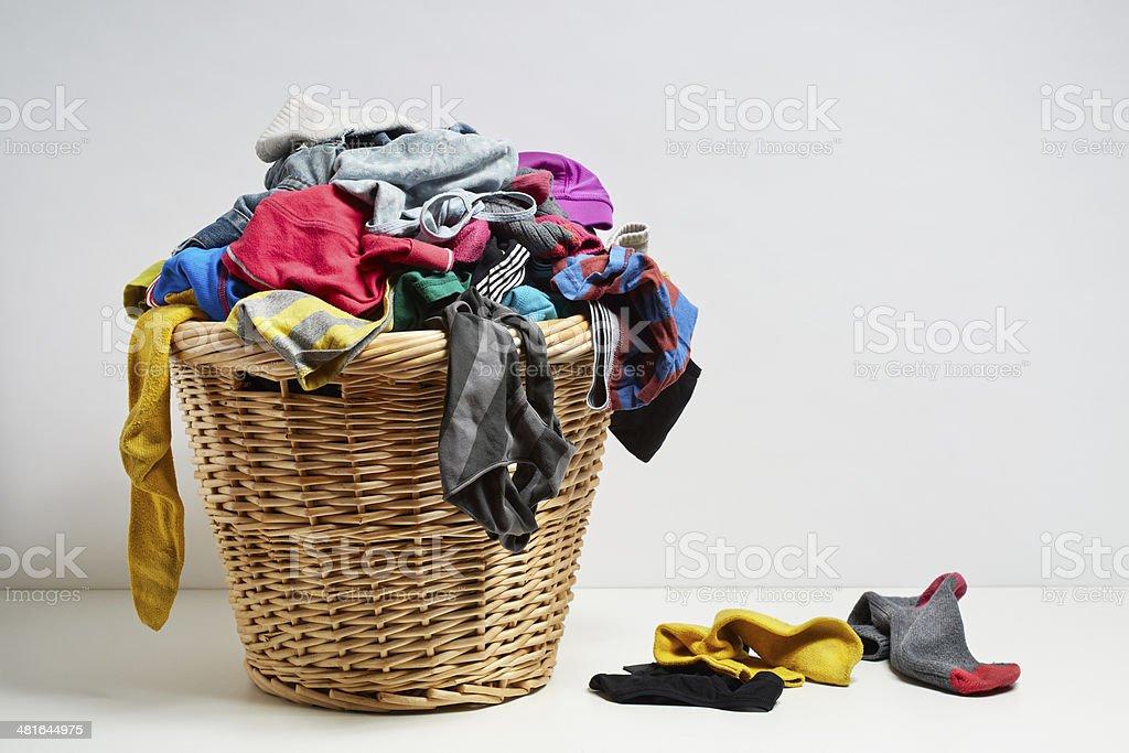 Overflowing laundry basket stock photo