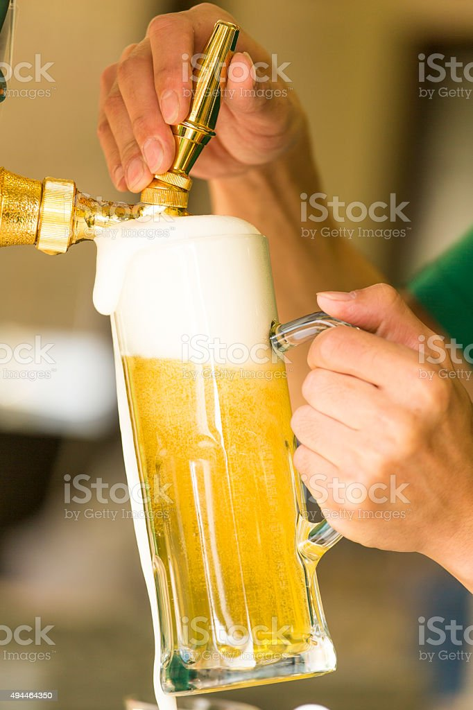 Overflowing Mug of Beer stock photo